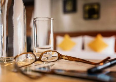 close up of brown glasses and clear drinking glasses