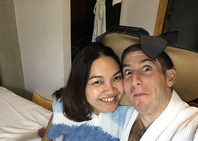 honeymoon couple travelers fun selfie inside of Butterfly Pea hotel room